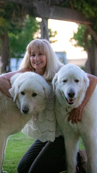 Woman and Two White Dogs